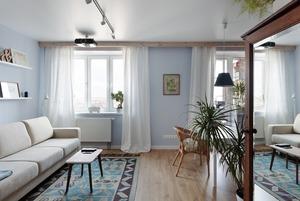 Скандинавская квартира-студия с винтажным шкафом