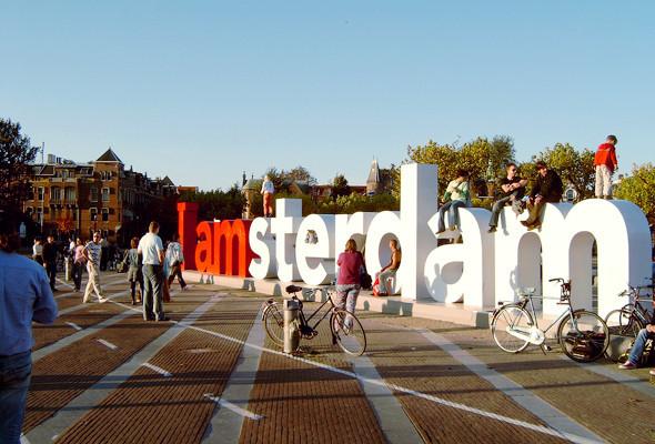 Город в образе: Авторы логотипов Амстердама, Мадрида и Пулы — о брендинге города. Изображение № 30.
