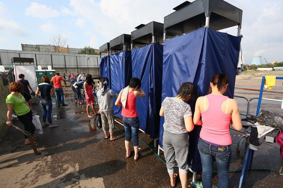 Фото дня: Палаточный лагерь для нелегальных мигрантов в Москве. Изображение № 4.